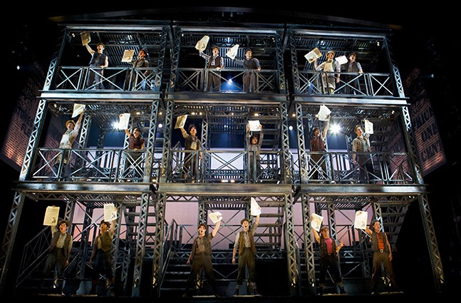 Newsies, the Musical 601 Disney's Newsies, directed by Jeff Calhoun at Papermill Playhouse 9/15-10/16/11 Music by Alan Menken Lyrics by Jack Feldman Book by Harvey Fierstein Based on the Disney Film written by Bob Tzudiker and Noni White Choreography by Christopher Gattelli Lighting Design:Jeff Coiter Costume Design: Jess Goldstein Set Design: Tobin Obst Photograph © T Charles Erickson http://tcharleserickson.photoshelter.com/
